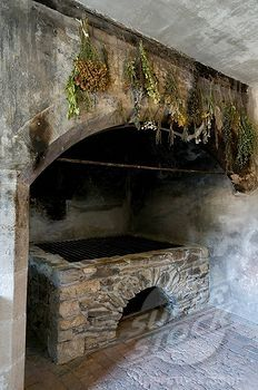 Unidentified image of Medieval-style kitchen with drying herbs.  Image would be useful for a virtual worlds creation.