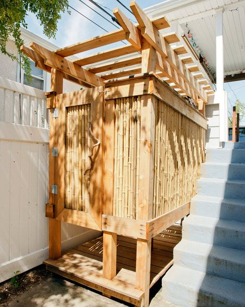 Outdoor shower with cali bamboo fencing panels it has a