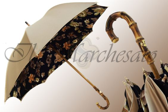 Automatic umbrella with shaft and 8 fiberglass ribs. Imitation ivory handle and…