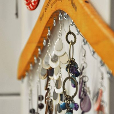 Screw eye screws into a wooden hangers to organize earrings and necklaces. - diy home sweet home: 50 Insanely Clever Organizing Ideas