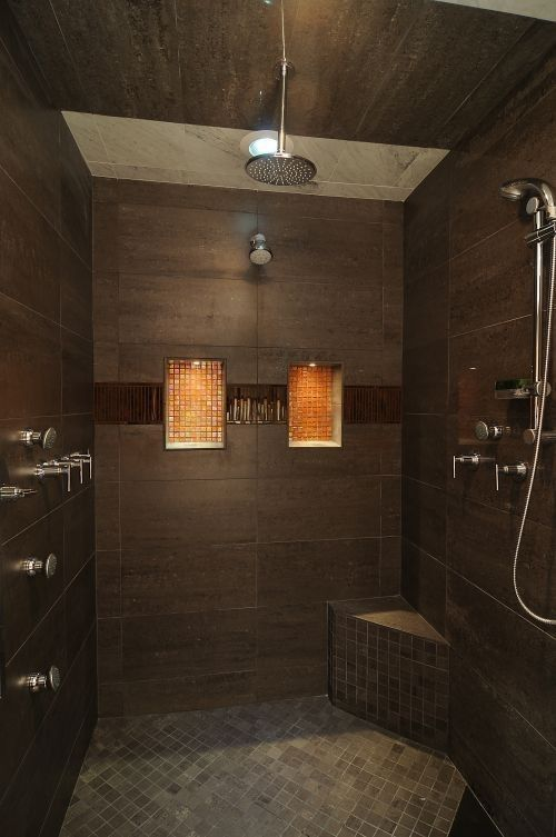 Dark brown shower with large tiles and glass accents for Brown tile bathroom ideas