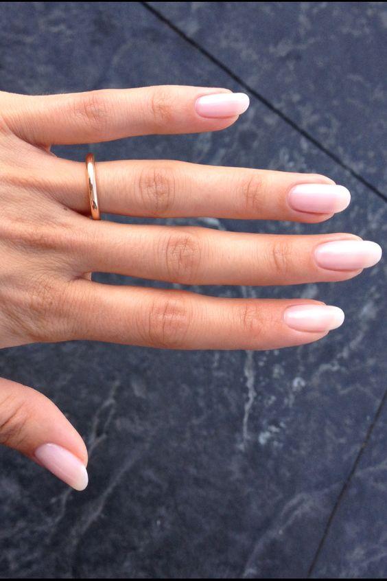 Rounded nails. Natural nail with Shellac gel polish. More