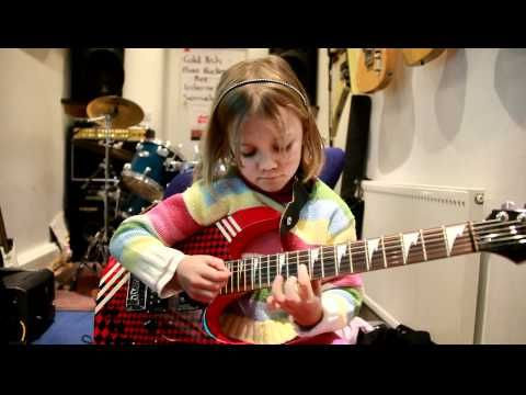 Zoe at aged 7 playing Sweet Child Of Mine. Zoe now plays in The Mini Band, who have become an internet sensation after their video of Metallica's Enter Sandman went viral.