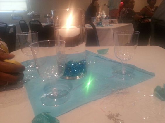 A candle floating in water with pebbles at the bottom. #weddingreception