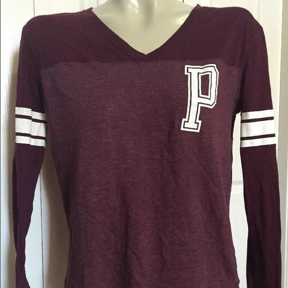 "PINK by Victorias Secret Maroon Long Sleeve Shirt PINK by Victorias Secret Maroon Long Sleeve V Neck Shirt   Size XS  ""P"" on front left chest  Stripes on both biceps  Cotton polyester blend  34"" chest 24"" length  Preowned PINK Victoria's Secret Tops Tees - Long Sleeve"