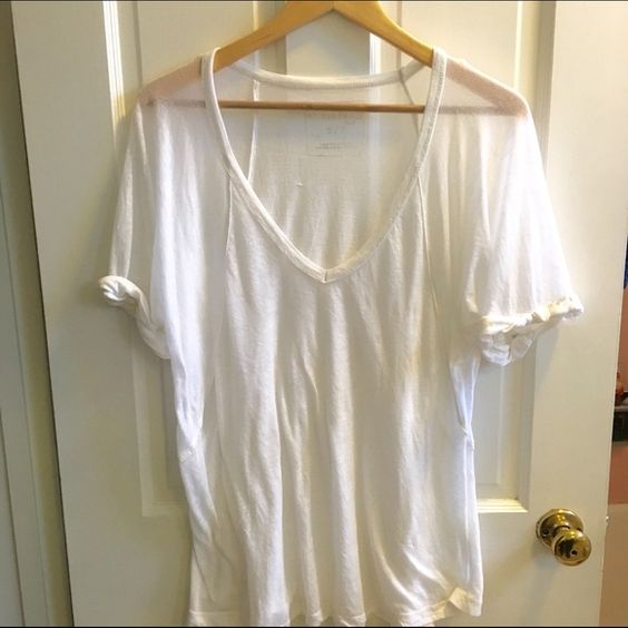 Free People White Tee Worn quite a bit,  but still soft classic white tee. Free People Tops Tees - Short Sleeve