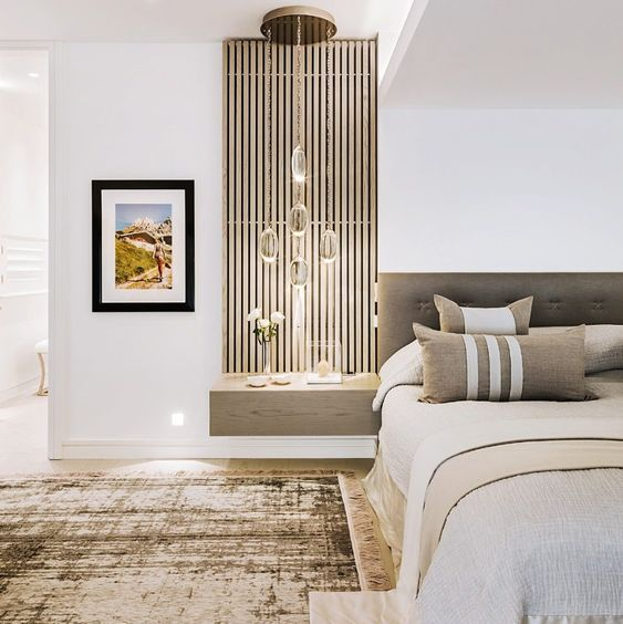 Kelly Hoppen's bedroom: Love the vertical slat floating nightstand next to the minimal headboard. Interesting focus. Love the balance of value and texture. The rug is fantastic.  #designerbedroom #nightstandlove