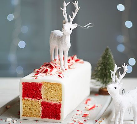 This checkerboard cake, with alternating red peppermint and vanilla sponges, makes a stunning Christmas gift or party centrepiece - why not get older children to have a go with this fun, festive project?