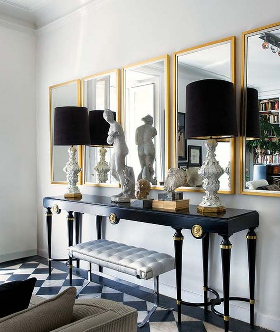 Inside an Apartment That's Black and White and Chic All Over// Mirrors, black lampshades, marble floors: Decorating Idea, Interior Design, Console Table, Living Room, Black White, Black Gold, Gold Mirrors