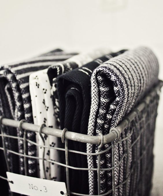 just kitchen towels in a metal basket                                                                                                                                                     More