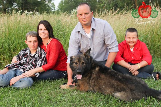 A family picture isn't complete without the animal!