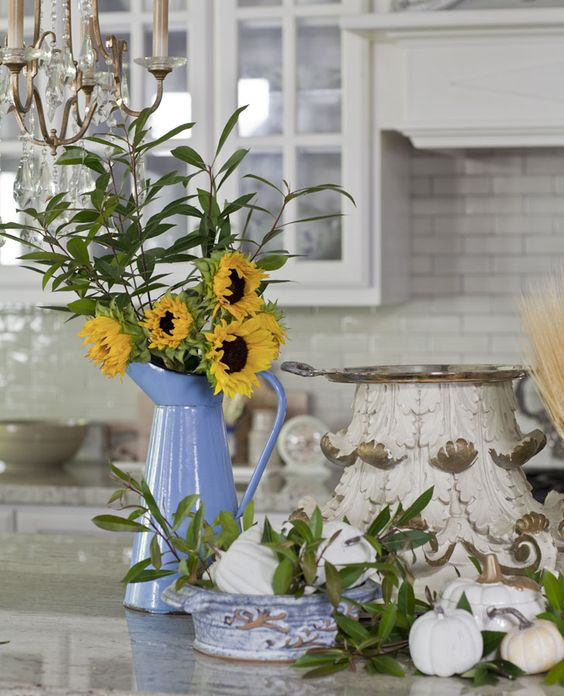 Sunflowers in a blue pitcher bring a pop of color to the kitchen. Elegant Fall Decor from Cedar Hill Farmhouse.