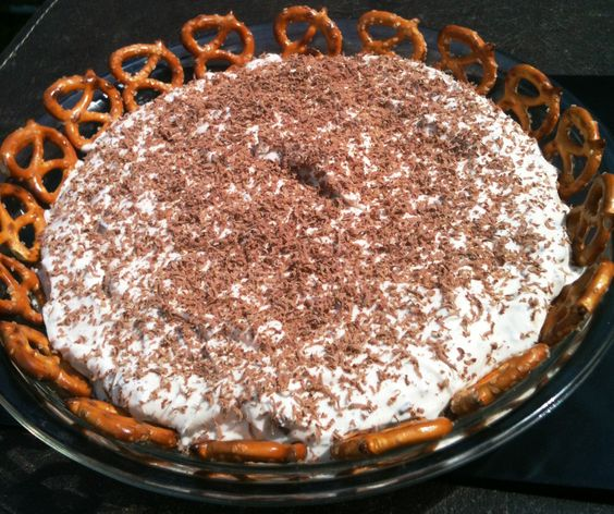Snickers Dip      2  (8 oz) pckgs of creamcheese, softened      1  (8 oz) Cool Whip      1/4 c brown sugar      6 Snickers bars, chopped  Mix all ingredients together.  Chill overnight to blend the flavors.  Serve with pretzels or graham crackers.