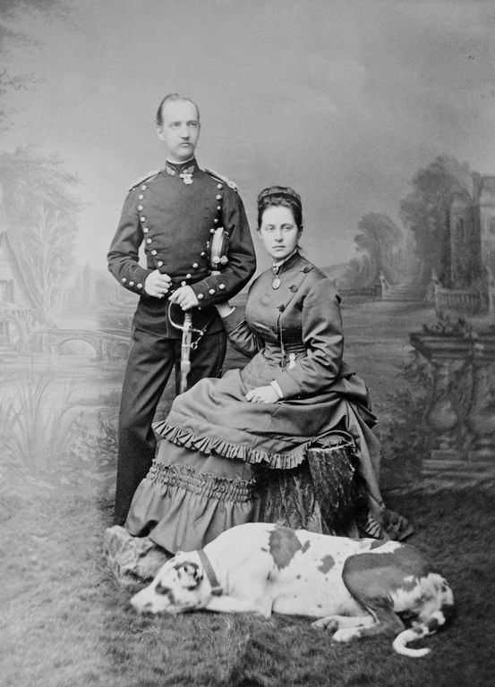 King George I and Queen Olga of Greece. George was a Danish prince, recruited by the fractious Greeks to become their king. He was assassinated in 1913. The Queen was a Romanov Grand Duchess.