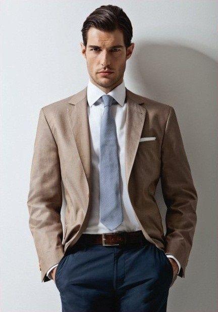 khaki colored blazer, blue grey tie, blue pants, white shirt