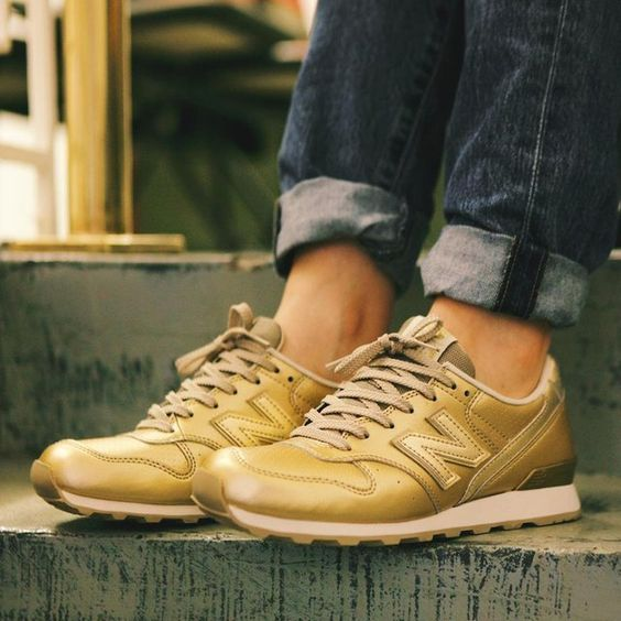 New Balance Women's WR996EE. Metallic Gold upper with perforated toe. Please allow 2 weeks for shipping.