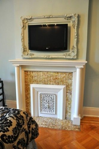 Antique frame around wall-mounted TV. Now I just have to figure out where to put the cable box and dvd.: