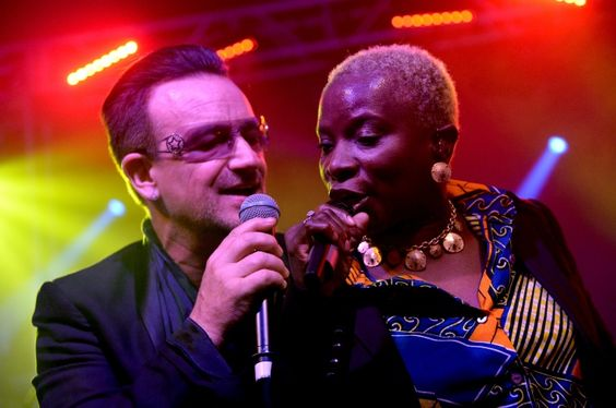 Up close and personal. U2's Bono and Angelique Kidjo team for a performance at the Jony Ive and Marc Newson's (RED) Auction after-party on Nov. 23 in New York