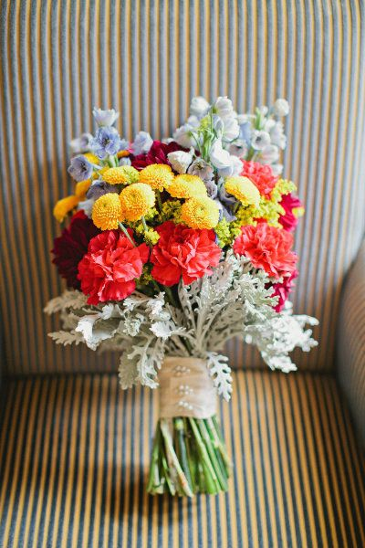 a bright bouquet perfect for a circus themed wedding Photography by Megan Thiele Studios / meganthiele.com, Floral Design by Sisters Floral Design Studio / sistersflowers.net