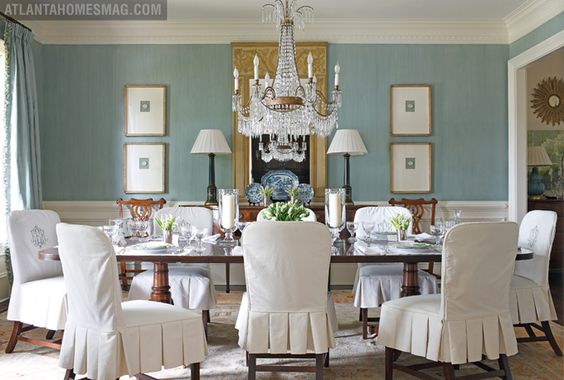 Gorgeous dining room chairs with monogram and beautiful blue walls.: