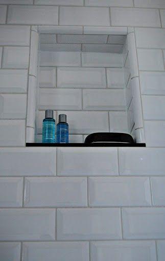 White Subway Tile Niche With Black Granite Shelf Family