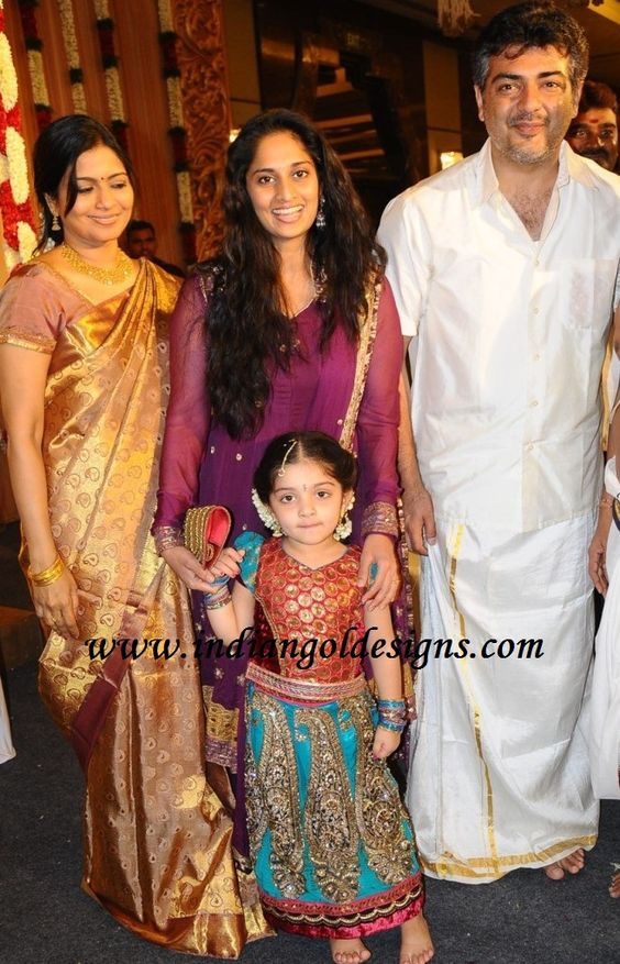 Shalini Ajith Ar In Traditional Gold Colour Silk Saree With Border Paired Matching Short Sleeves Blouse S Daughter