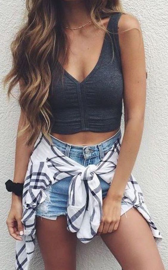 Gray bralette crop top, and denim cutoff shorts with a flannel wrapped around the waist.