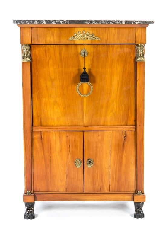 A Biedermeier Gilt Bronze Mounted Secretaire a Abattant 19th century having a rectangular marble top over a frieze drawer above a fall front writing surface opening to a fitted interior over two paneled doors. Height 57 1/4 x width 38 x depth 17 7/8 inches.