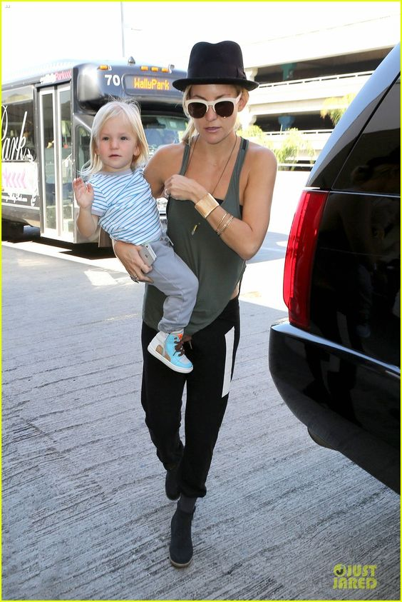 Kate Hudson departs a flight at LAX Airport with her boys Ryder and Bingham on October 11, 2013
