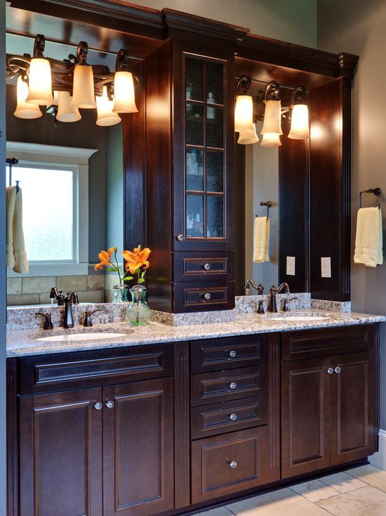 Bathroom double vanity cabinet between sinks design for Bathroom sink remodel ideas