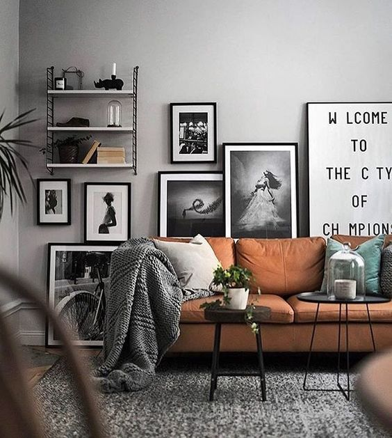 Scandinavian Living Room Modern Light Brown Couch Black And White Posters On The Wall Living Room Scandinavian House Interior Scandinavian Design Living Room