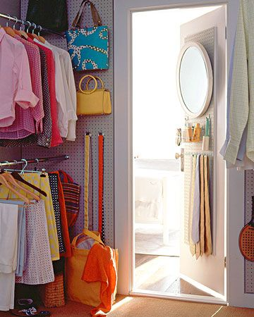 Peg board walls for extra hanging space in the closet