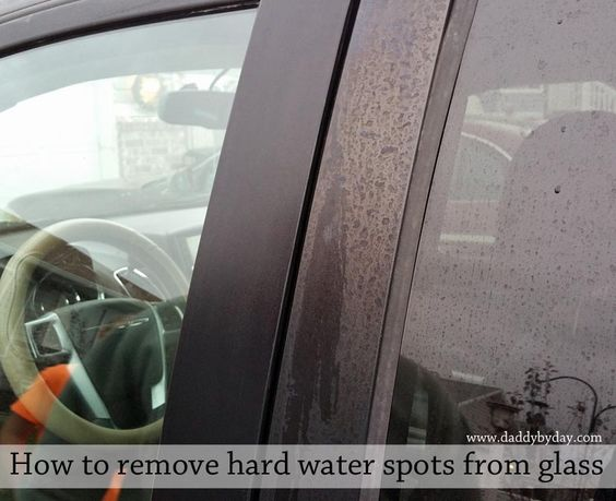 Easy and effective way to remove hard water spots from glass cause by sprinklers. Video, pictures and details.