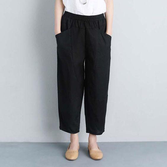 Pantalones holgados en color negro con bailarinas.