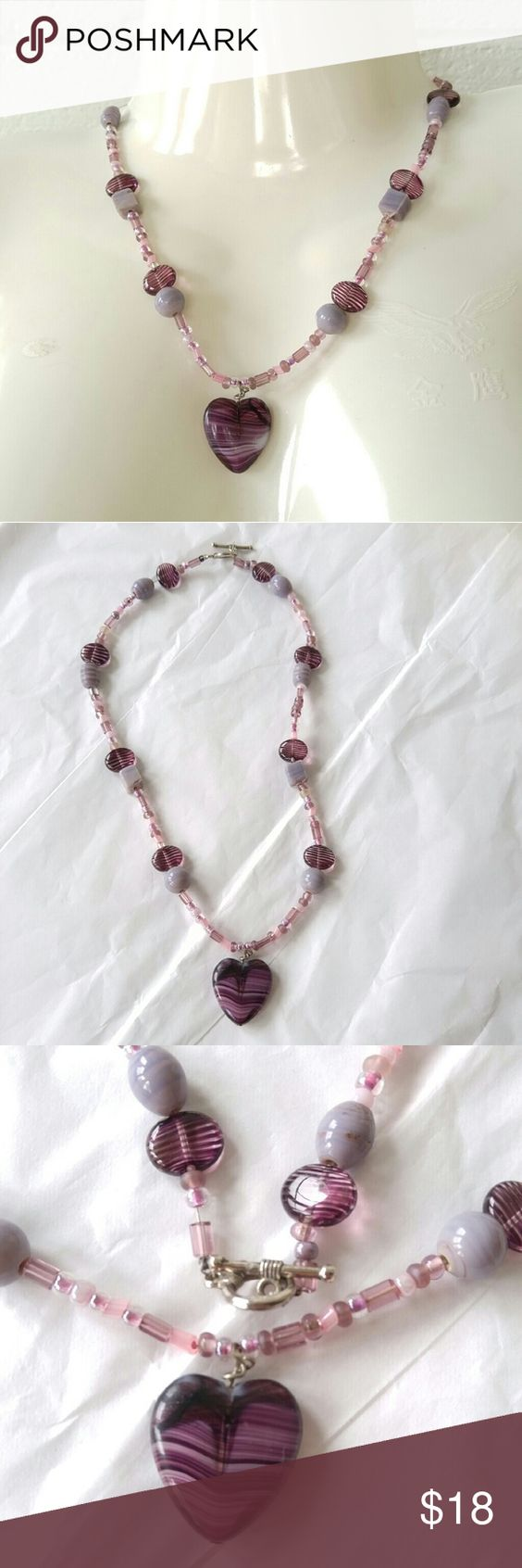 Handmade heart beaded necklace purple stones Beautiful beaded necklace with purple striped heart pendant on a chain of stone and glass beads in purple, pale gray blue, and pink. Silver tone toggle clasp. Strung on strong bead wire. Handmade by unknown artisan. From a smoke free home :)  SUNB8817HEART888 Handmade Jewelry Necklaces