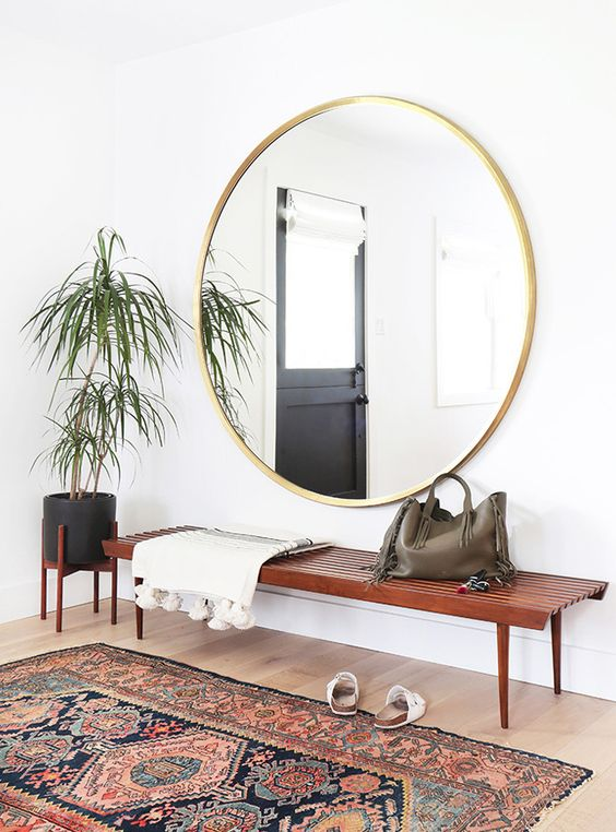 rugs in the home | traditional rug made modern | hallway decor | liven up a minimal space