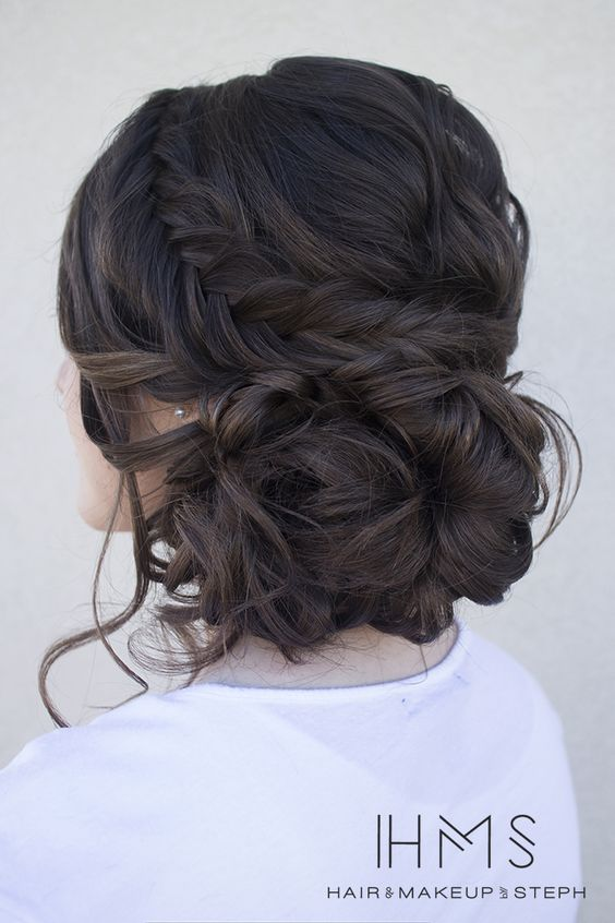 Messy buns combined with braids make for a seriously coveted prom up-do.