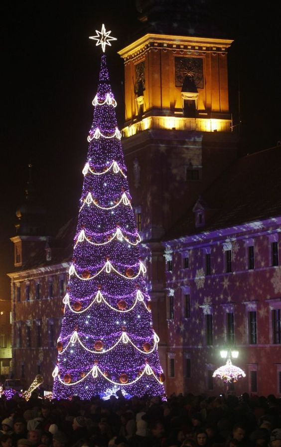 People enjoy the Christmas illuminations at the Royal Treaty street in Warsaw, Poland, Saturday, Dec. 1, 2012. (AP Photo/Czarek Sokolowski)