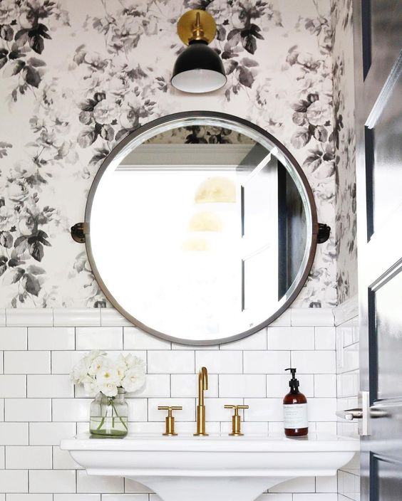 black and white floral wall paper, round mirror and white subway tile / Light fixture by Schoolhouse Electric