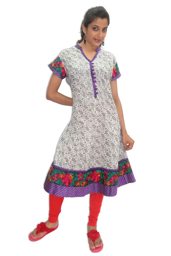 """Printed Cotton #Kurti With Embroidery Lace""  100% cotton printed below knee length and 1/4 sleeves kurti. Computer embroidery laces at bottom frill and sleeves makes it casual cum formal wear. V neck with self fabric button at front slit. Note : Legging not included in price.  -Price: 695"