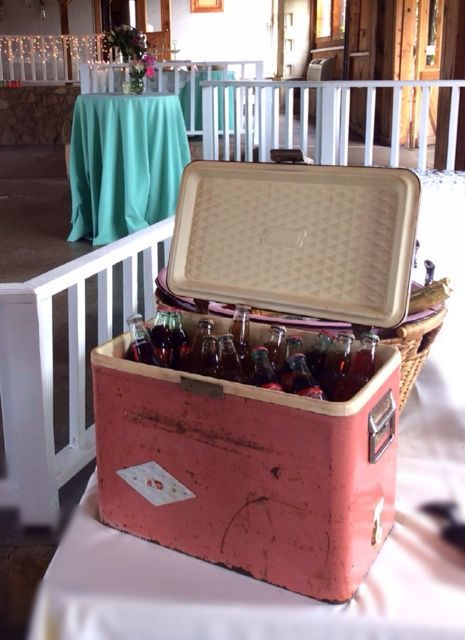 Chilled drinks for guests look charming in this vintage pink Coleman cooler. - Southern Vintage Table