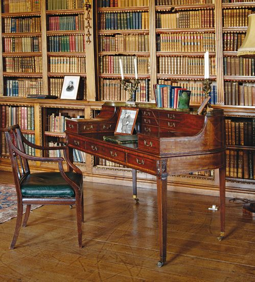 The elegant George III Carlton House desk (c.1780) sits in the Main Library at Highclere Castle & as seen in Downton Abbey