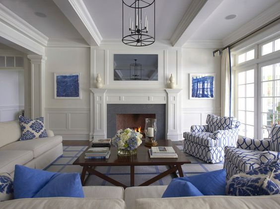 pop of color touches of bright blue in white family room