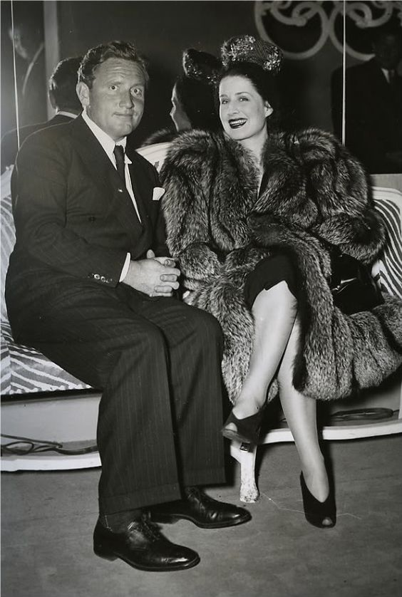 An obedient Spencer Tracy caught on camera with Norma Shearer:
