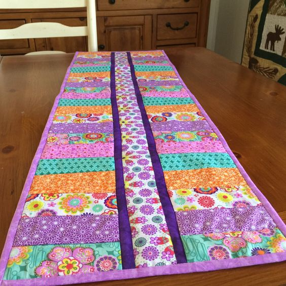 A personal favorite from my Etsy shop https://www.etsy.com/listing/227309799/modern-quilted-table-runner-in-vibrant