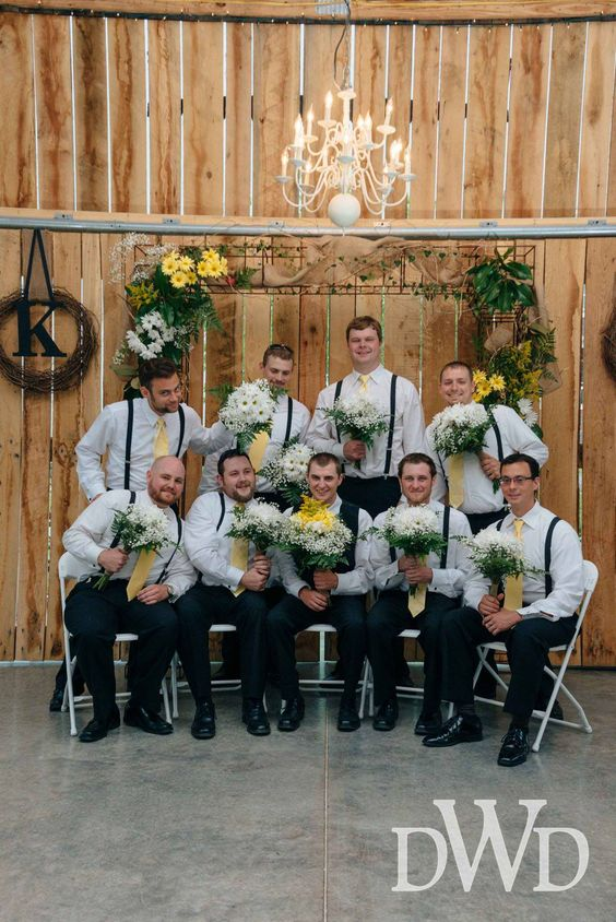 Guys look so sweet with flowers from Events at East 96 country barn wedding