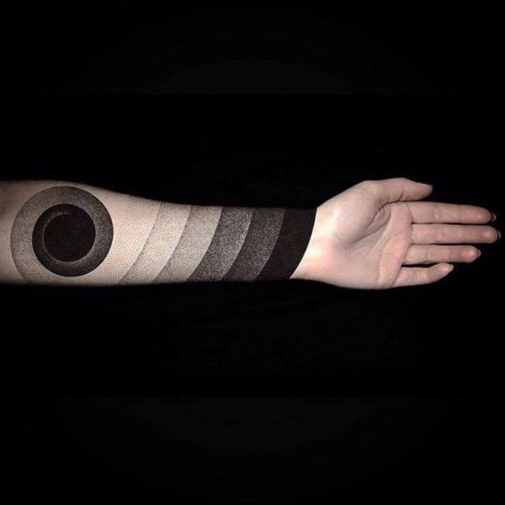 This amazing dotwork tattoo by Mark Hasselbach has something of the golden ratio for sure...