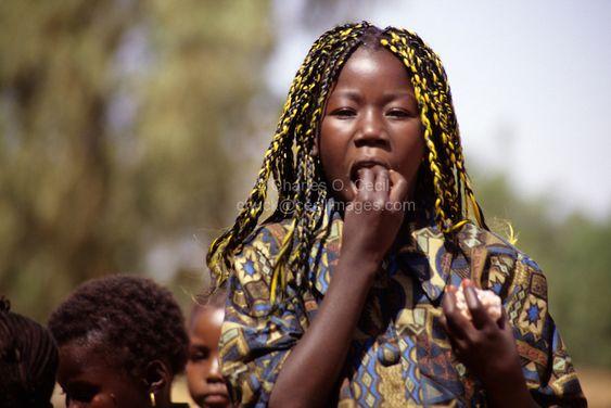 Niamey, Niger, Africa - Nigerien Girl with Yellow Braid in Hair.