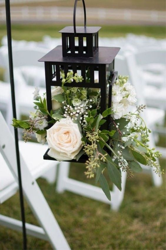 K'Mich Wedding - wedding planning - lantern black with white rose and greenery - wedding ideas blog by K'Mich - wedding planning services in Philadelphia PA