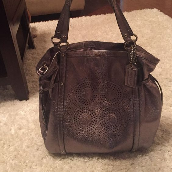 Coach tote. Authentic. Silver metallic coated leather with silver hardware. Can be worn as shoulder bag but also has long removable strap for wear as a crossbody. Like new. No signs of wear. May include dust bag upon request. Coach Bags Totes